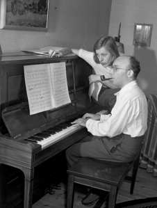 Theatrical composer Kurt Weill and his wife, performer Lotte Lenya, are seen at the piano at their home in New City, in the Rockland County suburb of N.Y., Aug. 17, 1942.  (AP Photo/Robert Kradin)