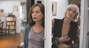 things-to-come-2016-006-isabelle-huppert-edith-scob-aside-doorway-original